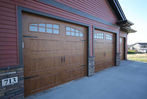 Wood Garage Doors Rustic Exterior Stebral Construction Home Builder Iowa City, Coralville, Solon, North Liberty