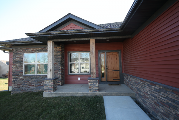 Front Pillars red Exterior Stebral Construction Home Builder Iowa City, Coralville, Solon, North Liberty