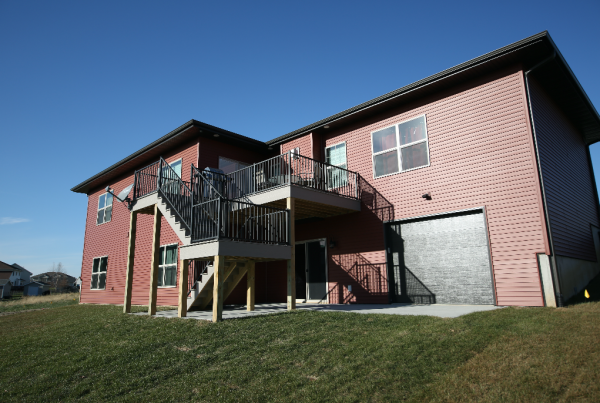 New Construction Red Exterior Stebral Construction Home Builder Iowa City, Coralville, Solon, North Liberty