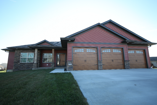 Red Exterior Home Wood Garage Doors Stebral Construction Home Builder Iowa City, Coralville, Solon, North Liberty