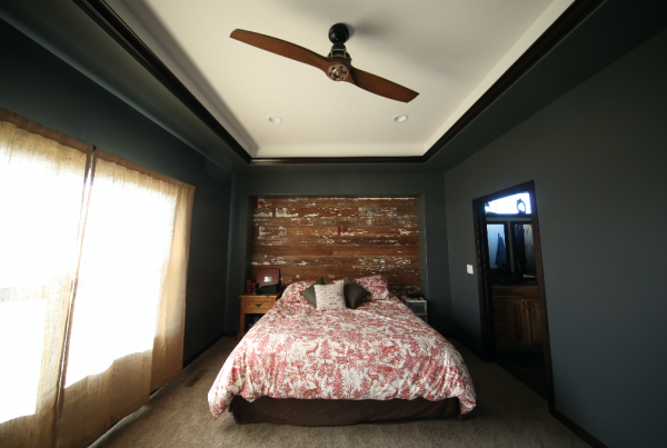 Bedroom with barnwood accent wall Stebral Construction Home Builder Iowa City, Coralville, Solon, North Liberty